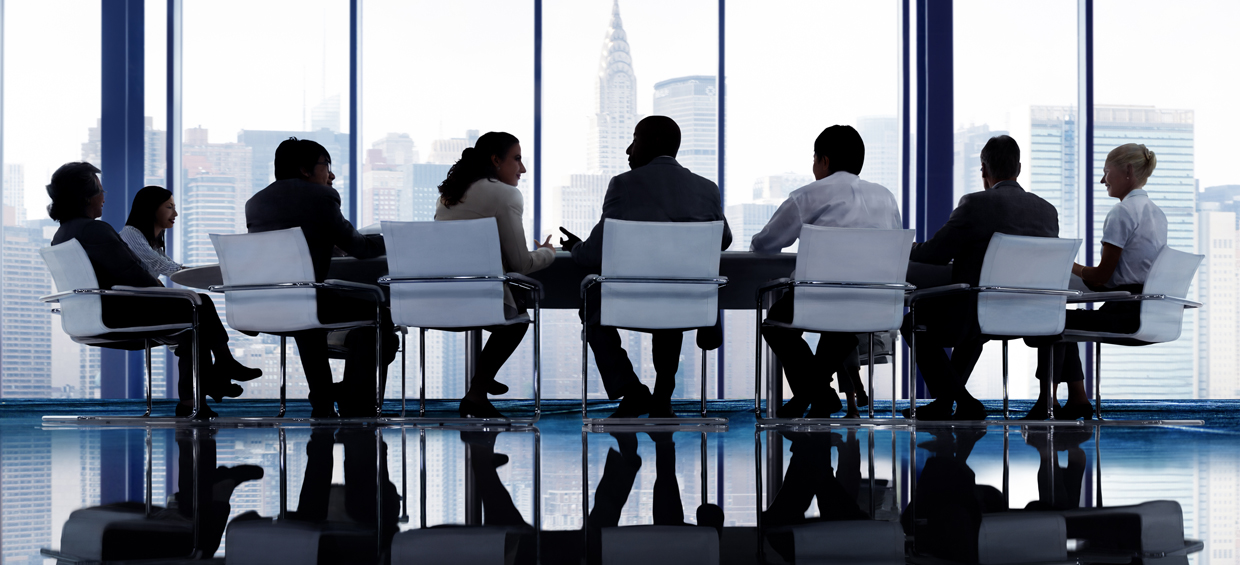 Board Members around a table - Sheer Velocity board of directors search firm